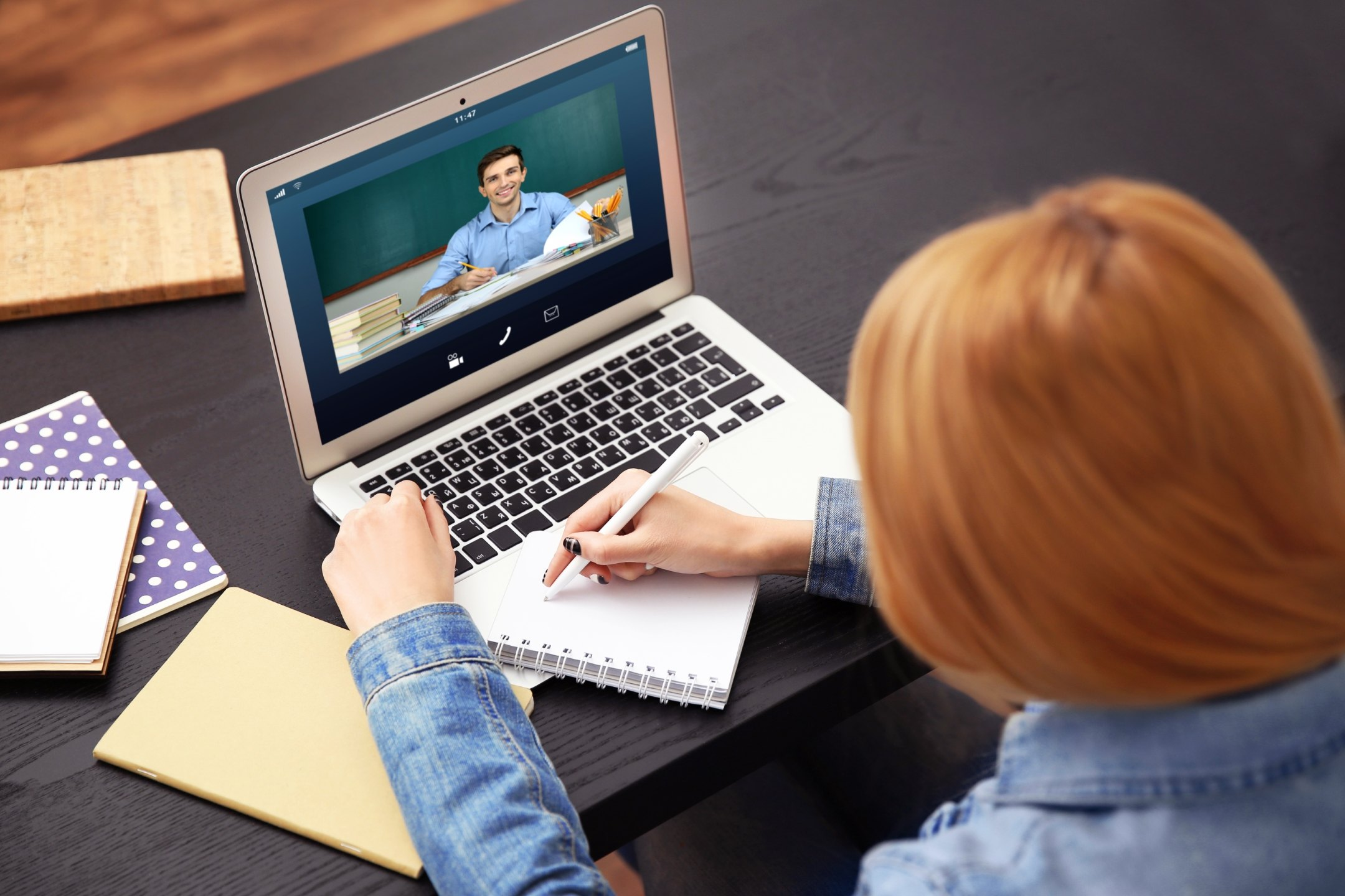 Woman,Video,Conferencing,With,Tutor,On,Laptop,At,Home.,Distance